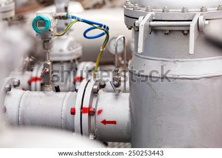 detail of oil pipeline with valves in large oil refinery - stock photo