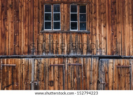 Detail of old and weathered wooden barn doors - stock photo
