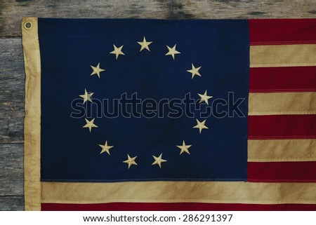 Detail of old dingy Betsy Ross Flag designed during the American Revolutionary War features 13 stars to represent the original 13 colonies. - stock photo