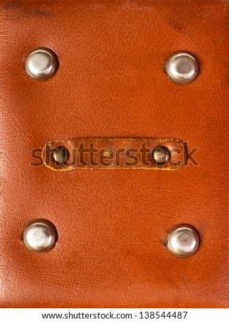 detail of old red leather briefcase closeup - stock photo