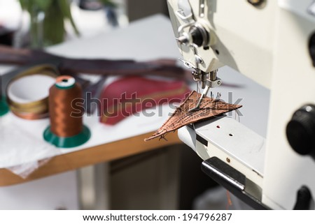 Detail of old sewing machine with a low depth of field - stock photo