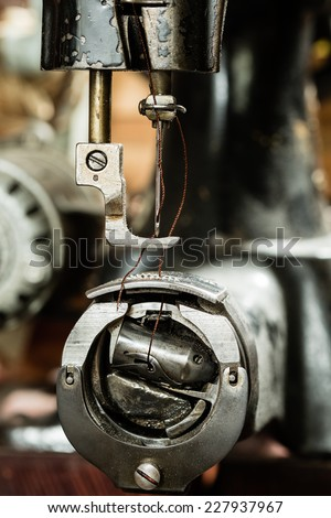 Detail of old sewing machine with a low depth of field. - stock photo