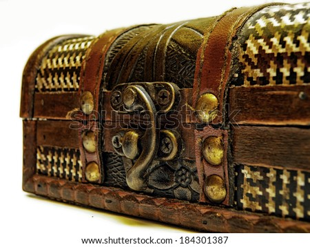 Detail of old treasure chest with gold chain. Isolated over white background. - stock photo