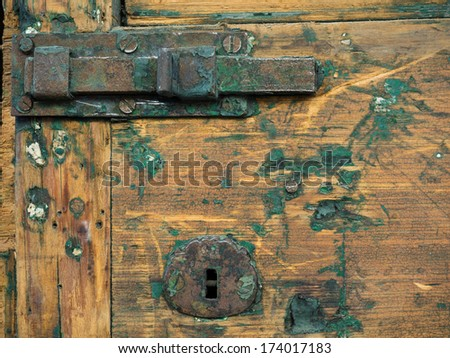 Detail of old wooden door with fading paint in French Quarter, New Orleans. - stock photo