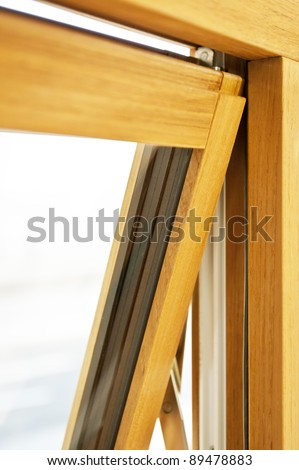 Detail of open wooden window with de-focused background - stock photo