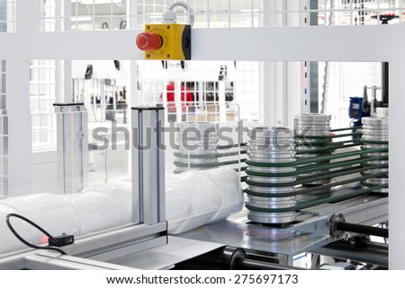 Detail of packaging machine for rolls - stock photo