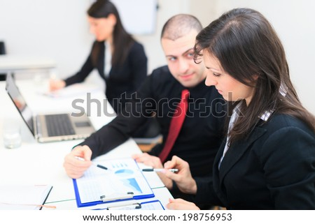 Detail of people at work during a business meeting - stock photo