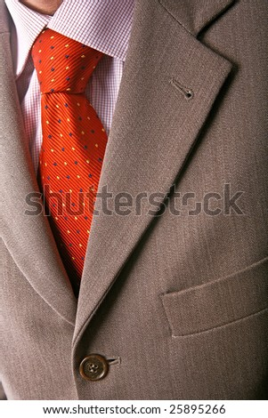 Detail of perfect business man grey suit with red tie 03 - stock photo