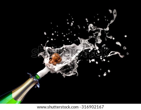 detail of popping champagne on black background - stock photo
