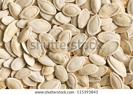 detail of pumpkin seeds background - stock photo
