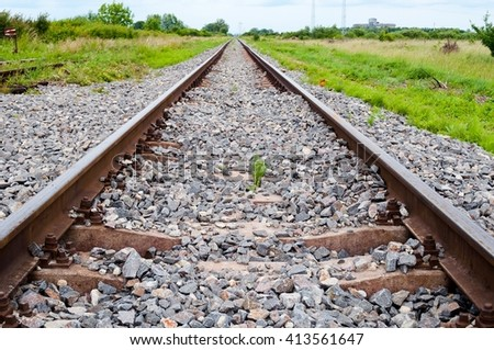 Detail of railway tracks with girder and gravel - stock photo