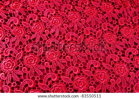 Detail of red lace pattern fabric - stock photo