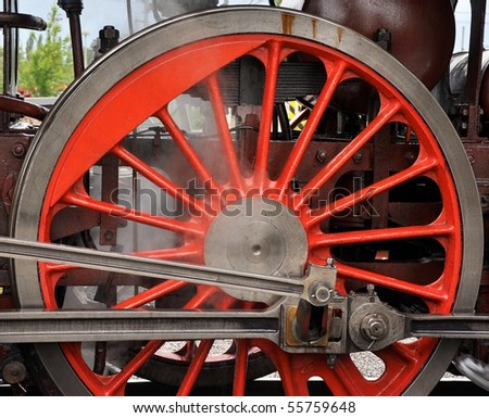 detail of red steam locomotive wheel - stock photo