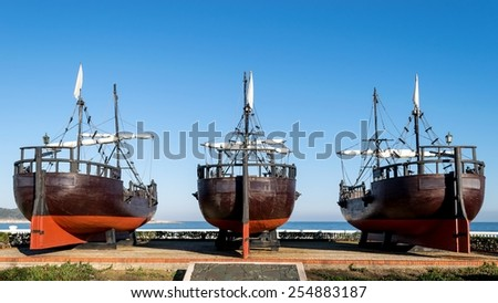 Detail of replicas of three caravels from the stern - stock photo
