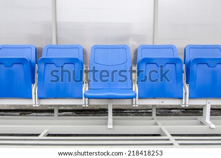 Detail of Reserve chair and staff coach bench in sport stadium - stock photo