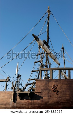 Detail of ropes, ladder and folded sails of a replica of a caravel - stock photo