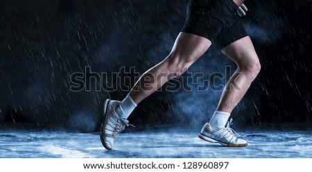 Detail of runne feet running in misty dark - stock photo