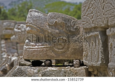 Detail of serpent carving at Chichen Itza - stock photo