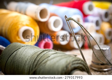 detail of sewing kit in the workroom - stock photo