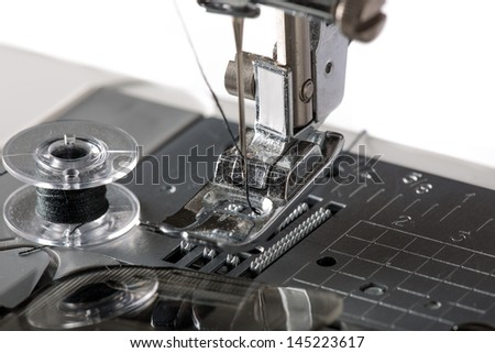 Detail of sewing machine and sewing accessories. - stock photo