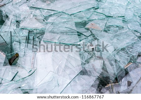Detail of sharp broken pieces of glass - stock photo