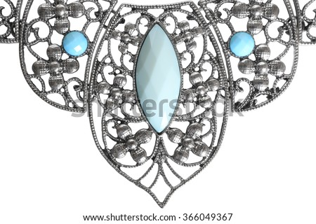 Detail of silver necklace isolated on white background - stock photo