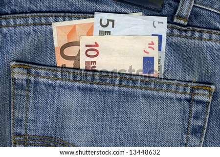detail of some blue pants with euros notes - stock photo