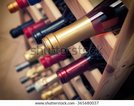 Detail of sorted wine bottles in some winery. - stock photo