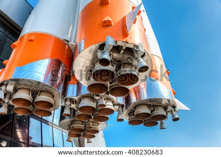 Detail of space rocket engine against the blue sky - stock photo