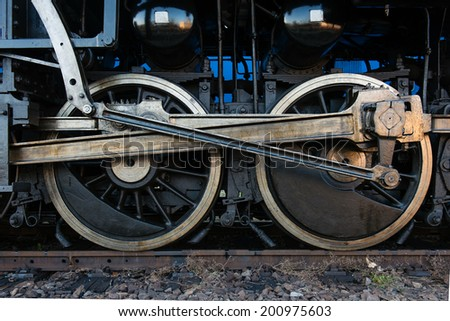 Detail of steam locomotive wheels - stock photo