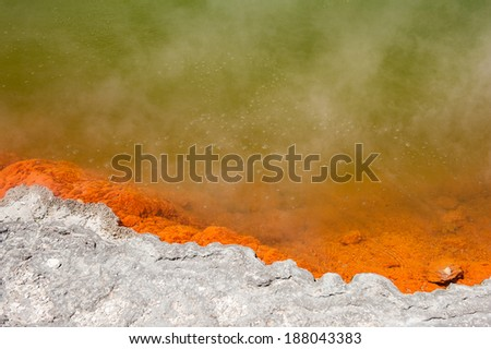 Detail of steaming spring with bubbles champagne pool in Wai-O-Tapu geothermal area, Rotorua, New Zealand  - stock photo