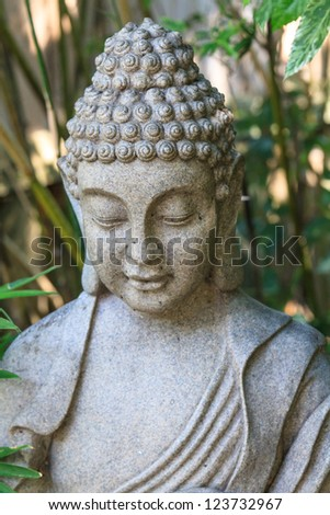 Detail of stone Buddha statue - stock photo