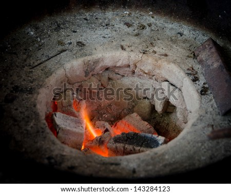 Detail of stove fire oven - stock photo