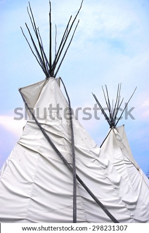 Detail of Teepee or wigwam topsagainst blue sky - stock photo