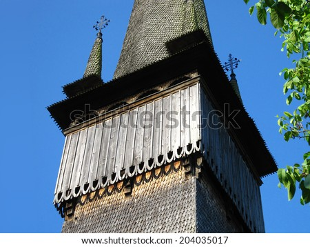 Detail of the bell tower of Church of the Archangels Michael and Gabriel, Surdesti, ROMANIA. One of eight Wooden Churches of Maramures that are listed by UNESCO as a World Heritage Site - stock photo