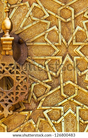 Detail of the brass door and knocker at the royal palace in Fez, Morocco. Islamic design and pattern. - stock photo