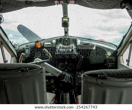 Detail of the cockpit of an old seaplane used for sightseeing  - stock photo