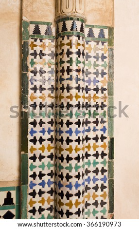 Detail of the decorative tiles covering the columns in the Court of the Mexuar, in The Alhambra, Granada, Spain - stock photo