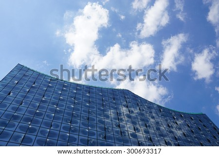 detail of the Elbphilharmonie building glass facade against the sky                                - stock photo