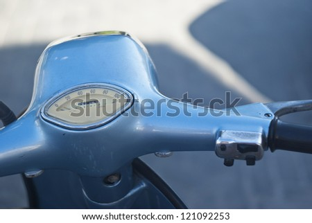 detail of the handlebar of an old Italian scooter - stock photo