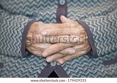 Detail of the hands of an elderly person - stock photo