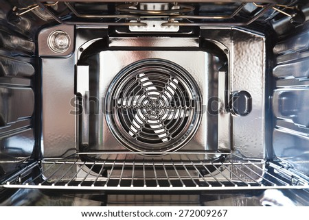 Detail of the interior of a modern oven built with fan - stock photo