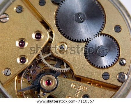 detail of the machine of a pocket watch - stock photo