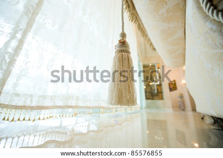 Detail of the modern sofa and curtain. - stock photo