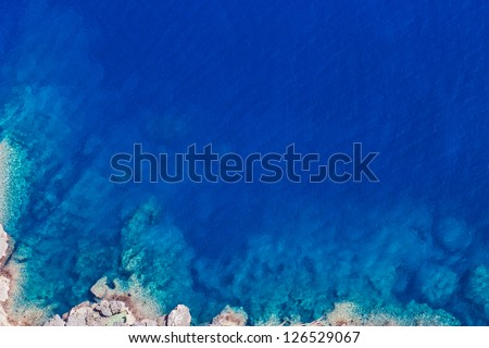 Detail of the rocks of a cliff coast in Mediterranean Sea in Spain - stock photo