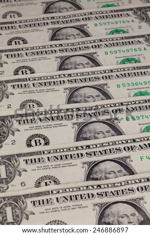 Detail of the same pattern of dollar bills on the table - stock photo