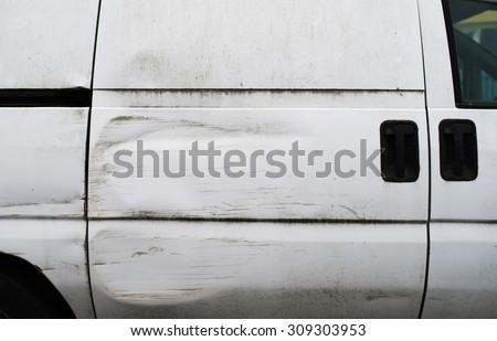 Detail of the side of a van which had an accident - stock photo