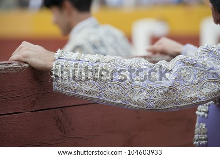 Detail of the sleeve of the jacket of a bullfighter embroidered with silver thread. - stock photo