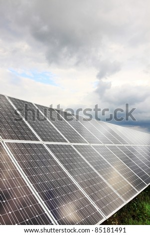 Detail of the Solar Power Station in the green summer Nature - stock photo