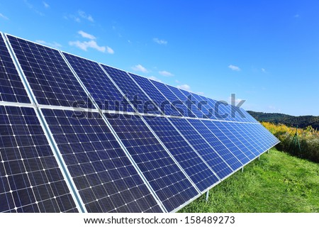 Detail of the Solar Power Station on the autumn Meadow  - stock photo